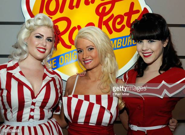 Models Doris Mayday Holly Madison and Claire Sinclair appear in Bettie Page style dress at Johnny Rockets at the Flamingo Las Vegas to celebrate the...