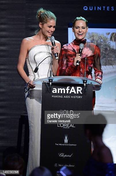 LR Models Doutzen Kroes and Aimee Mullins speak onstage at the 2012 amfAR's Cinema Against AIDS during the 65th Annual Cannes Film Festival at Hotel...