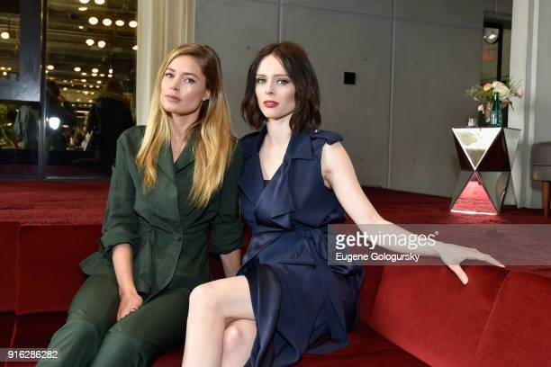 Models Doutzen Kroes and Coco Rocha relax in the Etihad VIP Lounge during IMG NYFW The Shows at Spring Studios on February 9 2018 in New York City