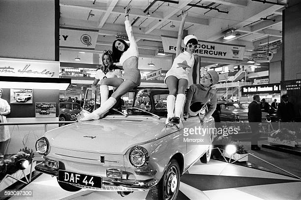 Models drapped over a DAF 44 car at the London Motor Show 18th October 1966