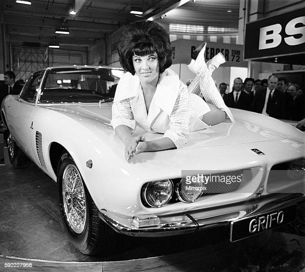 Models drapped over the latest Iso Grifo car at the 1966 London Motor Show 18th October 1966