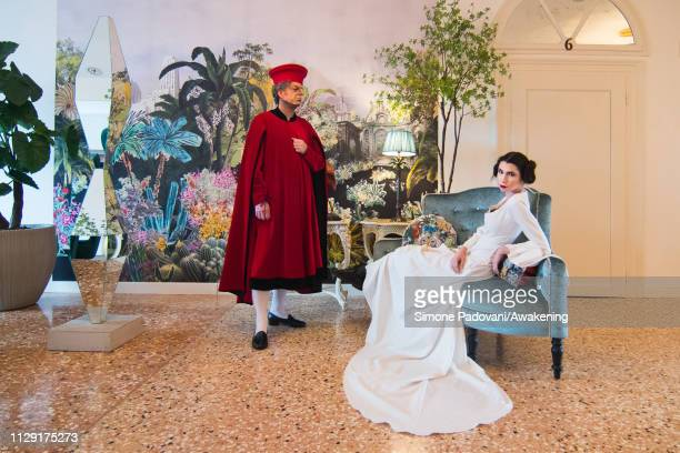 Models dress a male red velvet dress from the second half of the 1400s taken from a Bellini subject and a white dress with long train inspired by...
