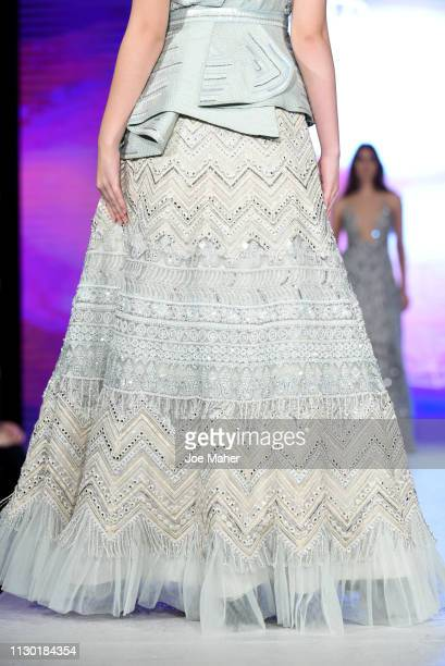 Models dress detail walk the runway for Aarti Mahtani at the House of iKons show during London Fashion Week February 2019 at the Millennium...