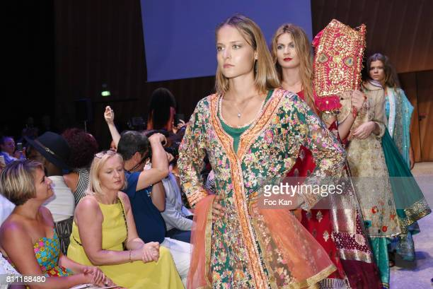 """Models dressed by Amal Sultana Khan walk the runway during the """"Paris Appreciation Awards 2017"""" At The Eiffel Tower on July 8, 2017 in Paris, France."""