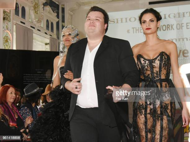Models dressed by Dimitri Vincent Petit walk the Runway during 'Fashion Night Couture' 8th Edition at Galerie de Miroirs on April 25 2018 in Paris...
