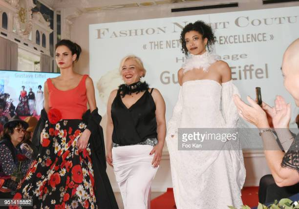 Models dressed by Isabelle Di Matteo walk the Runway during 'Fashion Night Couture' 8th Edition at Galerie de Miroirs on April 25 2018 in Paris France