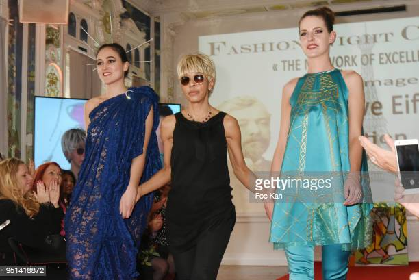 Models dressed by Marie France Vemabel walk the Runway during 'Fashion Night Couture' 8th Edition at Galerie de Miroirs on April 25 2018 in Paris...