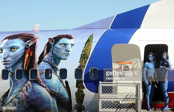 Models dressed up as characters from the film 'Avatar' depart a branded plane during the launch of 'AVATAR' Bluray and DVD at Sydney Domestic Airport...