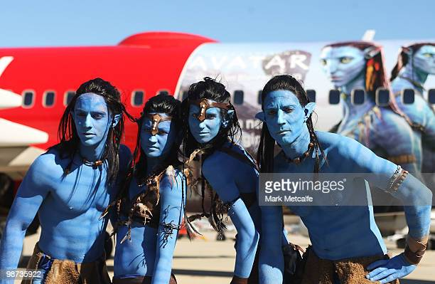 Models dressed up as characters from the film 'Avatar' pose in front of a branded plane during the launch of 'AVATAR' Bluray and DVD at Sydney...