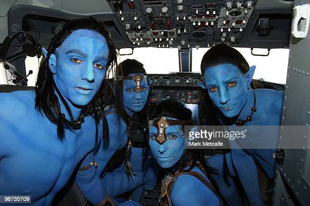 Models dressed up as characters from the film 'Avatar' pose in the cock pit during the launch of 'AVATAR' Bluray and DVD at Sydney Domestic Airport...