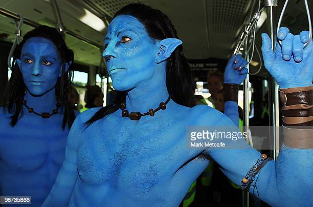 Models dressed up as characters from the film 'Avatar' travel on an airport shuttle bus during the launch of 'AVATAR' Bluray and DVD at Sydney...