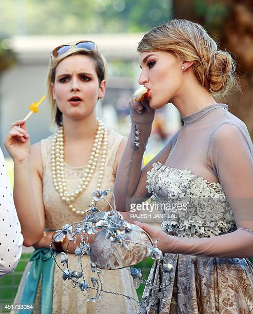 Models dressed up for a fashion competition eat ice cream during the annual Durban July horse race on July 5 in Durban South Africa The Durban July...