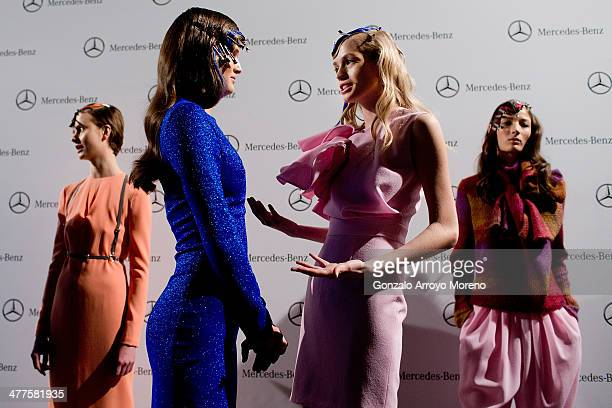 Models dressed up with Maria Barros designs talks prior to start the fashion show at the Mercedes Benz Fashion Week backstage on February 2014 in...