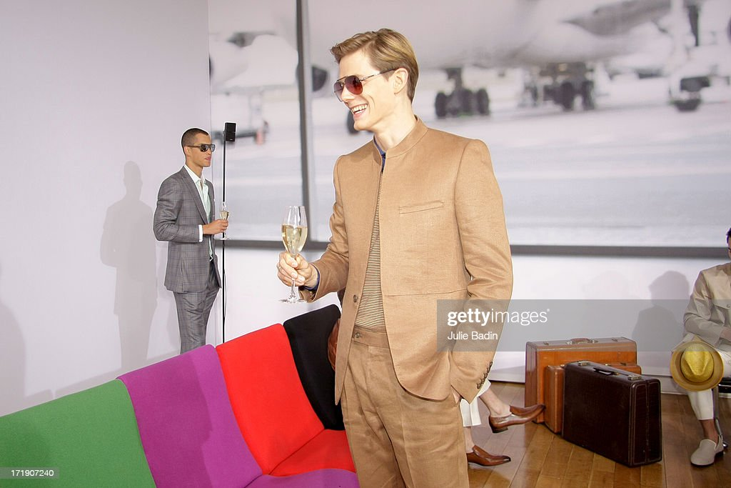 Models drink during the Francesco Smalto Menswear Spring/Summer 2014 Show As Part Of The Paris Fashion Week on June 29, 2013 in Paris, France.