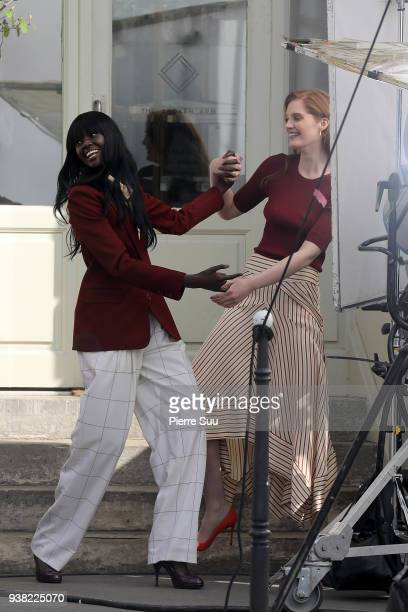 Models Duckie Thot Alexina Graham arrive on the set of new 'L'Oreal' shooting at 'Broken Arm Cafe' on March 26 2018 in Paris France
