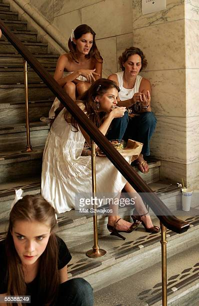 Models eat backstage at the Jill Stuart Spring 2006 fashion show during Olympus Fashion Week at the New York Public Library on September 12 2005 in...