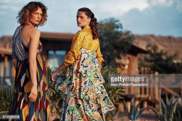 Models Elena Melnik and Alexandra Martynova pose at a fashion shoot for Madame Figaro on November 29, 2017 in Taghazout, Morocco. Alexandra: top ,...