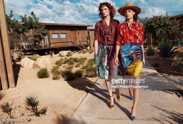 Models Elena Melnik and Alexandra Martynova pose at a fashion shoot for Madame Figaro on November 29, 2017 in Taghazout, Morocco. Alexandra: shirt...