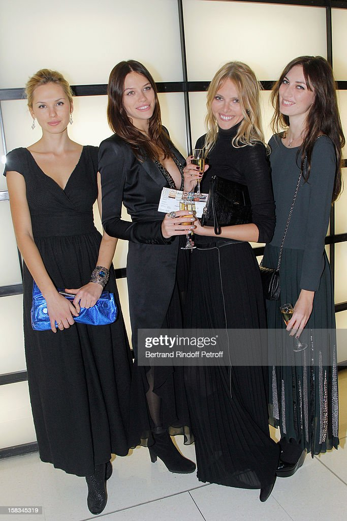 Models Elena Shura, Natalia Belova, Sasha Beznosyuk and Tatiana Chechetova attend the Arop Gala event for Carmen new production launch at Opera Bastille on December 13, 2012 in Paris, France.