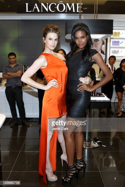 Models Eletra Weiderman and Arlenis Sosa pose during the celebration of Touchups Tango with Lancome spokesmodels Elettra Wiedemann Arlenis Sosa...