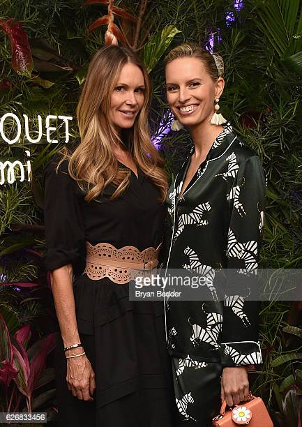 Models Elle Macpherson and Karolina Kurkova attend the L'Eden By PerrierJouet Rooftop Soiree With Karolina Kurkova on November 30 2016 in Miami Beach...