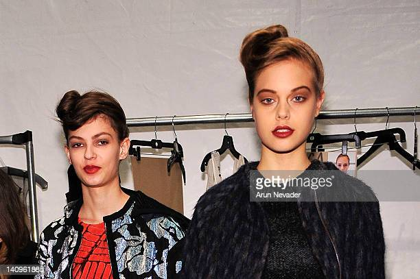 Models Emilia Nawarecka and Jessica Clarke seen backstage at the Lela Rose fashion show during Fall 2012 Fashion Week on February 12 2012 at The...