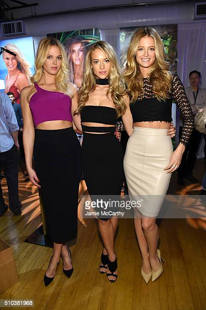 Models Erin Heatherton Hannah Ferguson and Kate Bock pose together at the Sports Illustrated Swimsuit 2016 Swim City at the Altman Building on...