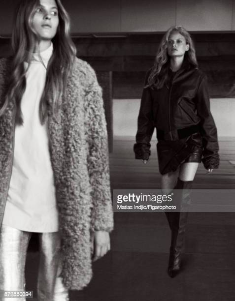 Models Estee Rammant and Nathalia O pose at a fashion shoot for Madame Figaro on September 19 2017 in Paris France Front Coat blouse pants Back...