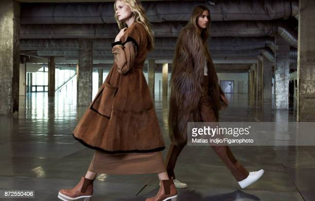 Models Estee Rammant and Nathalia O pose at a fashion shoot for Madame Figaro on September 19 2017 in Paris France Left Coat and dress boots Right...