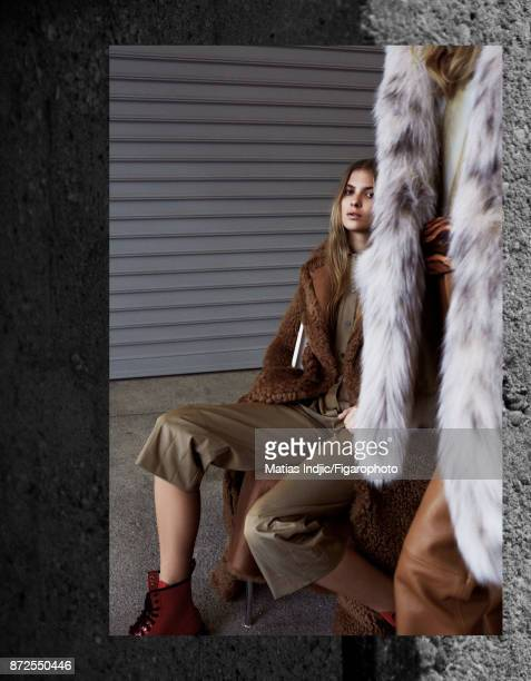 Models Estee Rammant and Nathalia O pose at a fashion shoot for Madame Figaro on September 19 2017 in Paris France Front Coat body pants and belt...