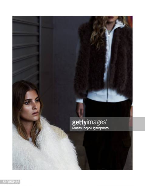 Models Estee Rammant and Nathalia O pose at a fashion shoot for Madame Figaro on September 19 2017 in Paris France Left Coat Right Vest sweater and...