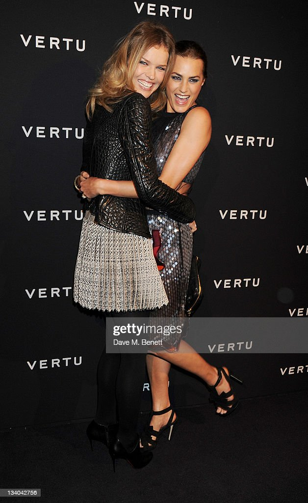 Models Eva Herzigova (L) and Yasmin Le Bon attend the launch of the Vertu Constellation, the luxury mobile phone maker's first touchscreen handset, at the Farmiloe Building on November 24, 2011 in London, England.