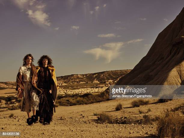 Models Fanny Francois and Alexandra Martynova pose at a fashion shoot for Madame Figaro on June 13 2017 in Spain Left Coat shirt skirt necklace boots...