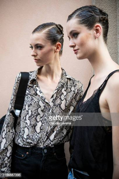 Models fashion details are seen outside Giorgio Armani show during the Milan Men's Fashion Week Spring/Summer 2020 on June 17 2019 in Milan Italy