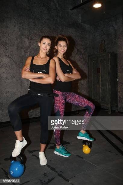 Models Fata Hasanovic and Fiona Erdmann pose during the opening of John Reed Fitness Music Club on April 10 2017 in Hamburg Germany