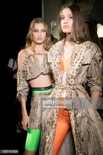Models Felice Nova Noordhoff and Altyn Simpson are seen backstage ahead of the Blumarine show during Milan Fashion Week Spring/Summer 2019 on...