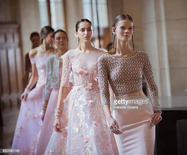 Models finish the runway during the Georges Hobeika Spring Summer 2017 show as part of Paris Fashion Week on January 23 2017 in Paris France