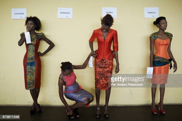 Models fit garments for the Nigerian London based designer Yemi Osunkoya a day before Kinshasa Fashion Week on July 17 at the boxing gym at Shark...