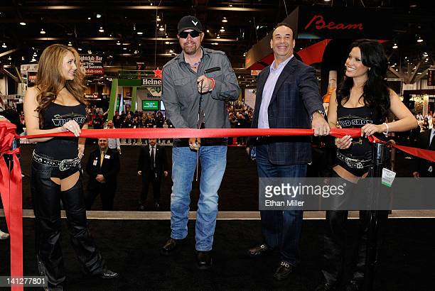 """Models flank recording artist Toby Keith and host and co-executive producer of the television show, """"Bar Rescue"""" and President of the Nightclub & Bar..."""
