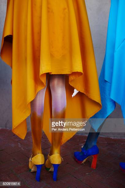Models for the designer label David Tlale waits before a fashion show at the colored community in BoKaap at the Mercedes Benz Cape Town Fashion Week...