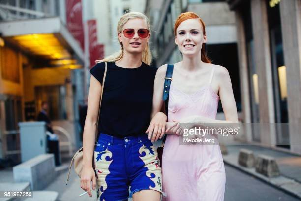 Models Frederikke Sofie Kiki Willems after the Fendi show on July 05 2017 in Paris France Frederikke wears redtinted sunglasses black top and jean...