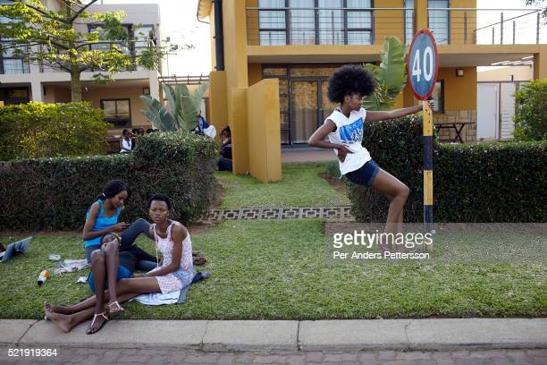 Models from Botswana relax during a casting in a golf estate for Color in the Desert Fashion week on August 30 2012 in Gaborone Botswana Color in the...