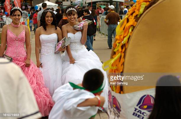 CINCO DENVER CO Models from left Sandra Parra Blanca Hernandez and Alejandra Camarena distributed catalogues for Novias Imperial a Denver company...
