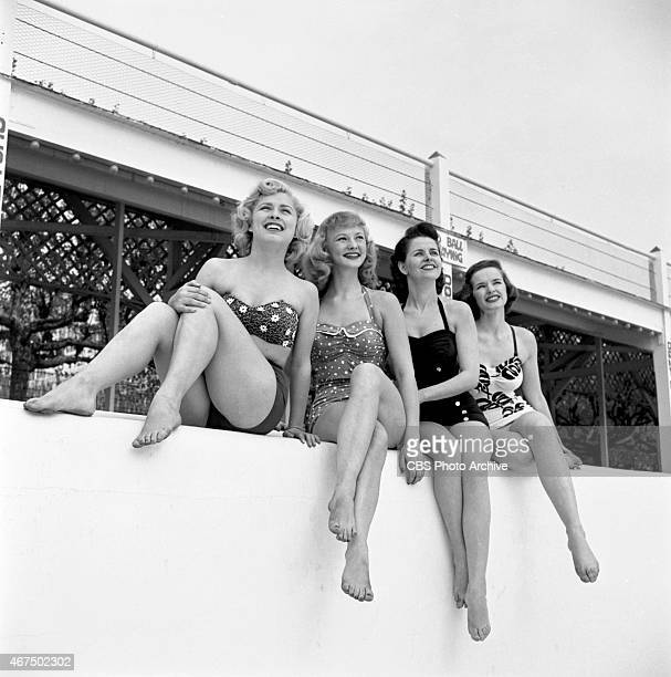 Models from the CBS gameshow The Big Payoff Cindy Robbins Connie Mavis Marion James and Pat Conway by the pool at Steeplechase Park Coney Island...