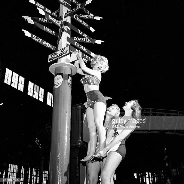 Models from the CBS gameshow The Big Payoff Cindy Robbins is lifted by Connie Mavis and Pat Conway at the Steeplechase Guidepost at Steeplechase Park...