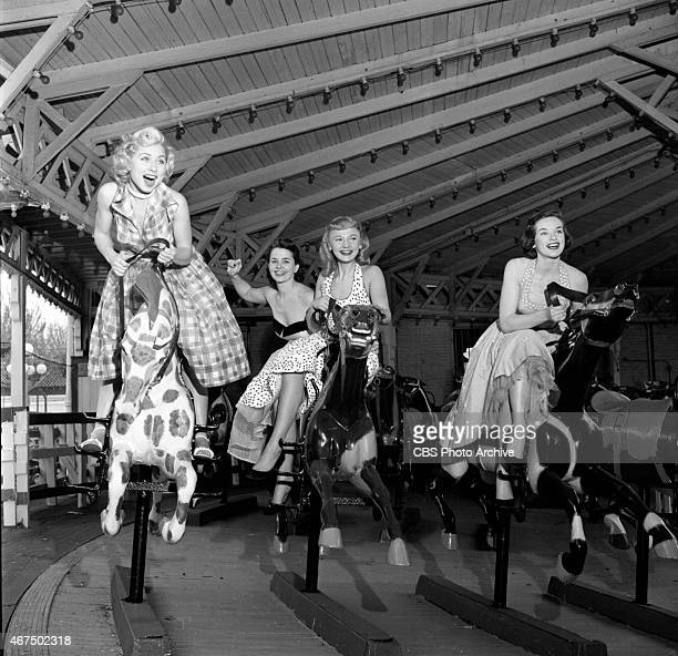 Models from the CBS gameshow The Big Payoff Cindy Robbins Marion James Connie Mavis and Pat Conway ride the Great American Derby Racer amusement ride...