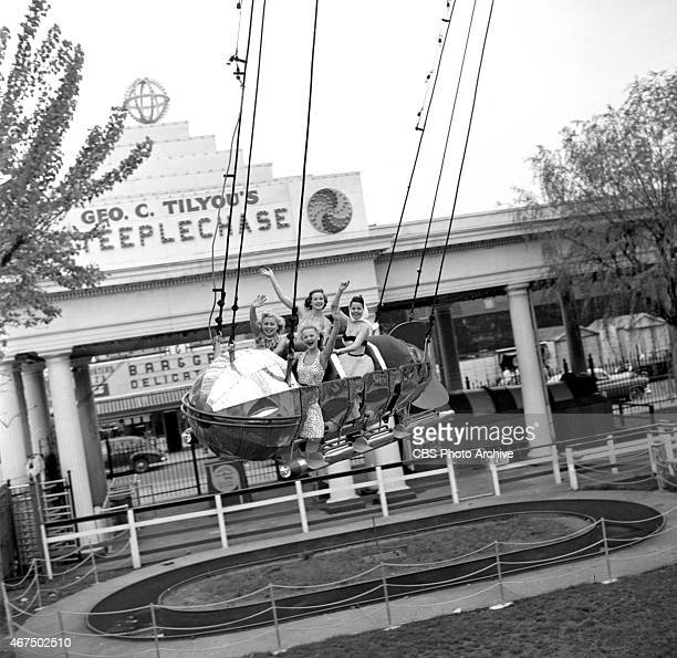 Models from the CBS gameshow The Big Payoff Cindy Robbins Pat Conway Connie Mavis and Marion James on the Rocket Ship ride at Steeplechase Park Coney...
