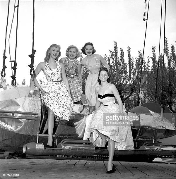 Models from the CBS gameshow The Big Payoff Connie Mavis Cindy Robbins Pat Conway and Marion James on the Rocket Ship ride at Steeplechase Park Coney...