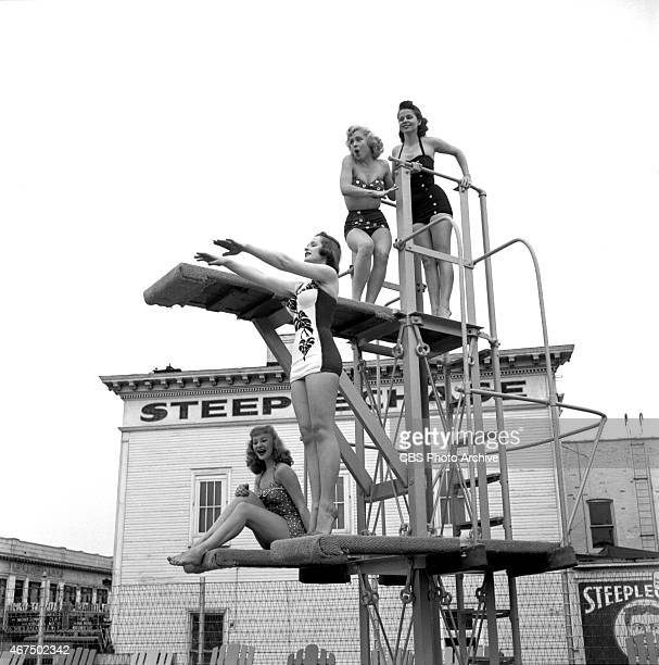 Models from the CBS gameshow The Big Payoff Connie Mavis Pat Conway Cindy Robbins and Marion James on the diving boards at the Steeplechase Park pool...