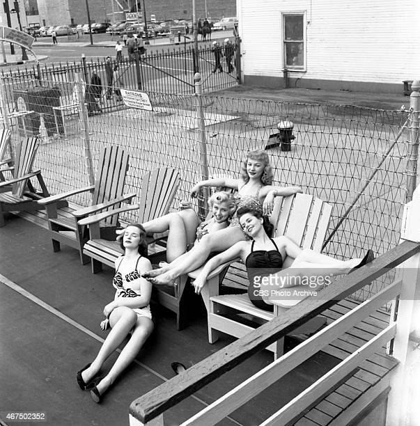Models from the CBS gameshow The Big Payoff Pat Conway Cindy Robbins Connie Mavis and Marion James lounge at the Steeplechase Park pool in...